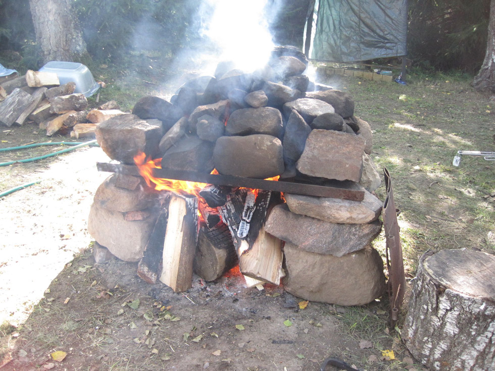 How To Make A Quick Sauna – A Big Pile Of Rocks, Fire And An Old Tent